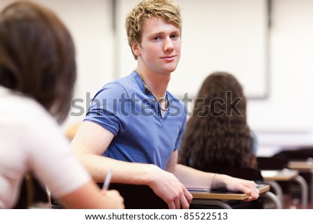 Student sitting at a table in a classroom