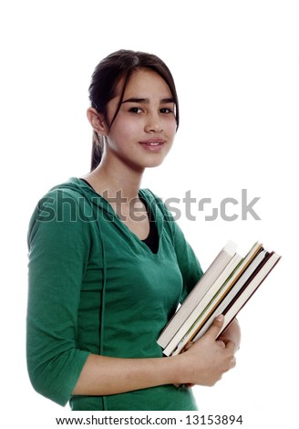 student smiling and carrying notebooks