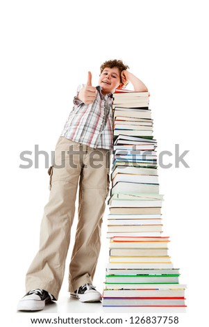 Student standing close to pile of books showing ok sign on white background