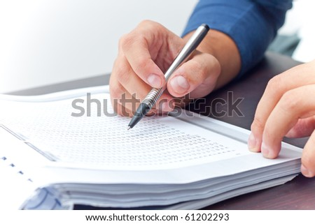 Student studying holding a pen