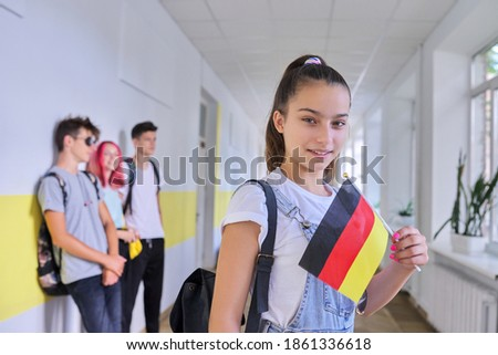 Student teenager girl with the flag of Germany inside school, school children group background. Europe, Germany, education and youth, patriotism, people concept Photo stock ©