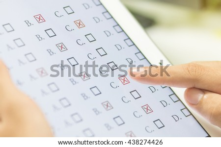 Student testing exercise, exams answer on tablet with multiple choice questions by finger clicking, Concept Educational technology, Training teachers to use computer technology improve confidence. #438274426