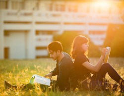 Student was reading in the outdoors and good weather. And they're happy.lens flare