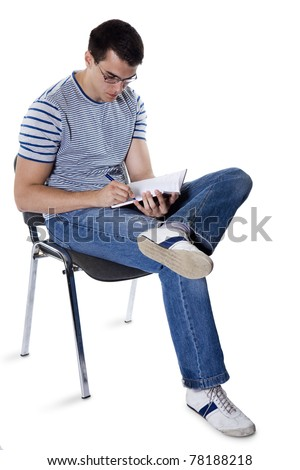Student with a notebook sits on a chair isolated a white background