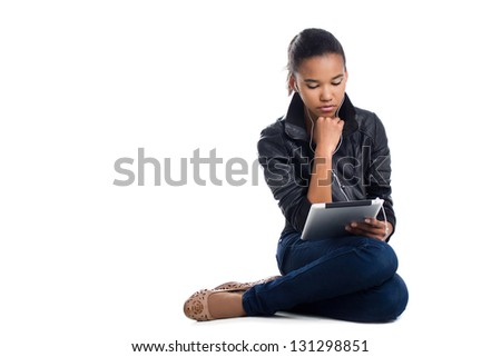 student with digital tablet sitting on the floor isolated on white