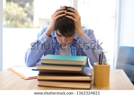 student with problems or stress at the desk