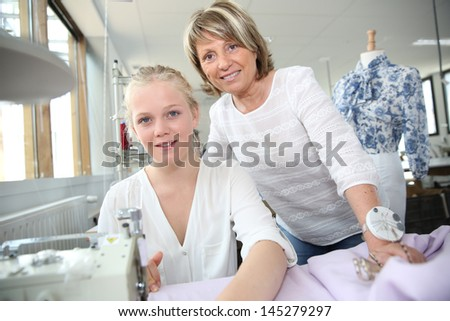 Student with teacher in dressmaking class