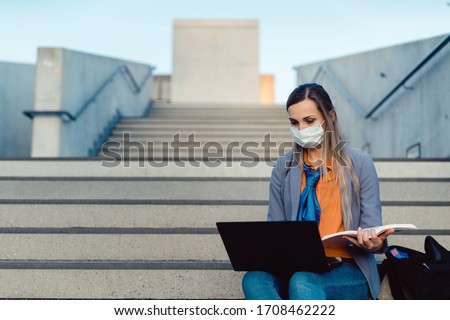 Student woman sitting on empty stairs of university campus working Stock photo ©