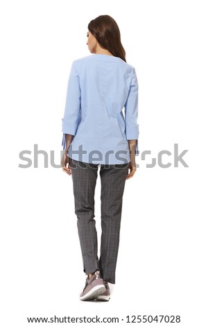 student young woman with model girl in formal long sleeve blue official blouse sneakers shoes full body photo isolated on white back view