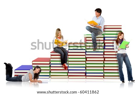 Students around a pile of books - isolated over a white background - stock photo