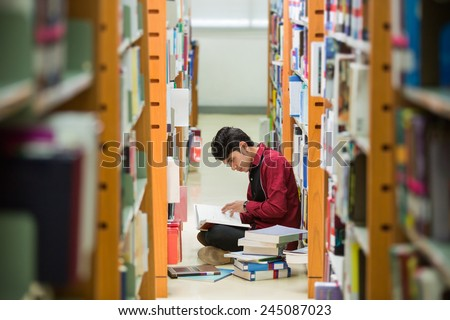 Students Asian men I read the book at the library The bookshelf - stock photo
