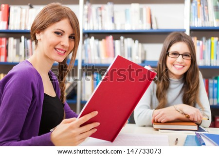 Students at work in a library