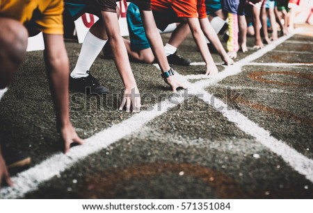 Students boy get set to leaving the starting for running competition boy at school sports day. School sports day concept.