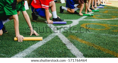 Students boy prepare to leaving the starting for relay race boy at school sports day. School sports day concept.