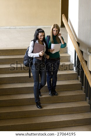 students climbing down stairs and chatting
