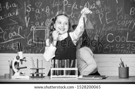 students doing biology experiments with microscope in lab. Happy children. Biology lesson. biology education. Biology equipment. Little kids learning chemistry in school laboratory. Scientist at work.