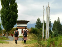 Students going to Home after school passing through beautiful stupa
