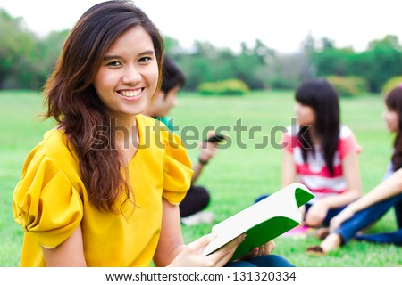 Students hanging out in the park.