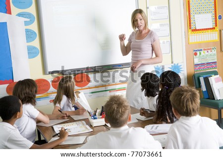 Students in class with teacher at board