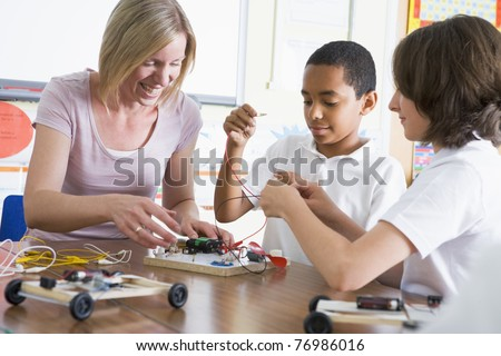 Students in class with teacher making electronic cars