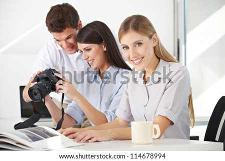 Students in photo class with photographer with camera and lenses