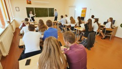 Students in the classroom are at their desks. Russian school.