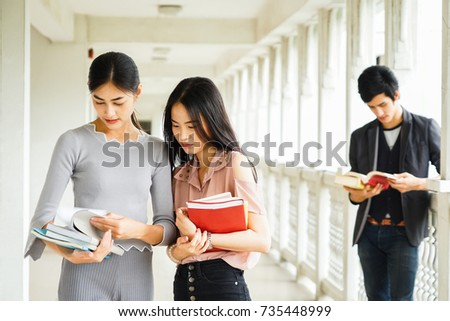 Students Reading Books In College Education Concept 735448999