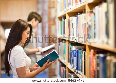 Students reading while standing up in a library
