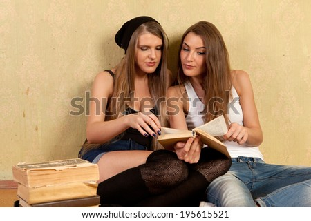 Students sit and read books, preparing for exams and tests
