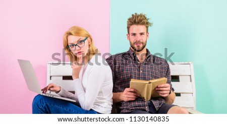 Students spend leisure studying. Couple students with book and laptop studying. Modern students use digital approach as well as classic textbooks. Man and woman use different learning approach. #1130140835