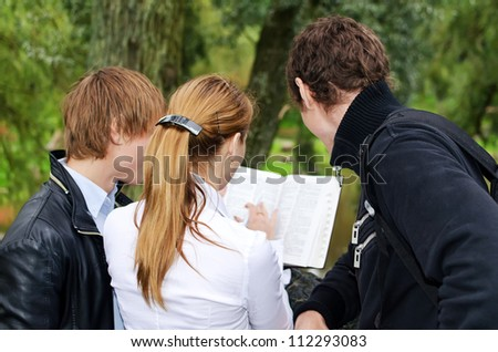 Students studying outdoors. Back view