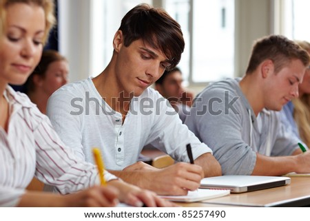 Students taking a test in university class