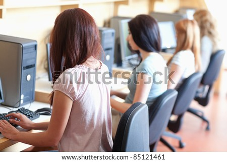 Students using computers in an IT room