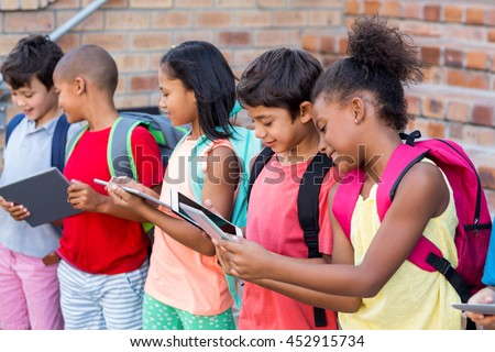 Students using digital tablets outside school #452915734