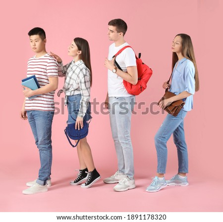 Students waiting in line on color background Сток-фото ©