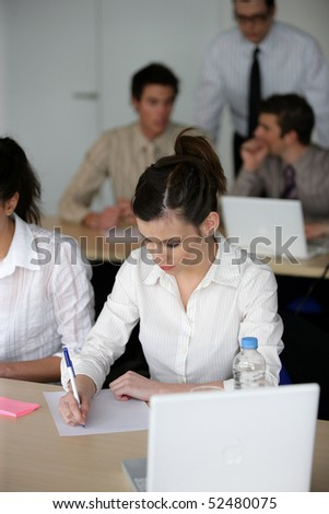 Students writing on document - stock photo
