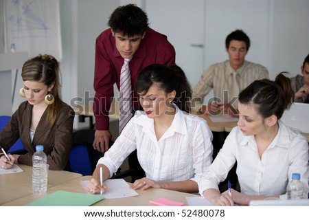 Students writing on document