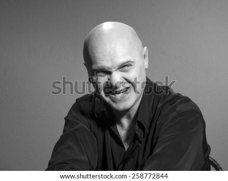 Studio black and white portrait caucasian bald men. Emotions. anger
