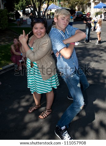 STUDIO CITY - SEPT 18: Raini Rodriguez (L) & Ross Lynch (L)  attends  T.J. Martell Foundation Family Day  at CBS Studios Backlot, September 18, 2011 in Studio City, CA