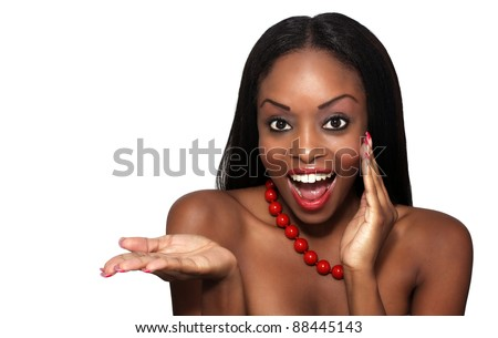Studio close-up of an extraordinarily beautiful young woman with an excited facial expression and her hand extended, palm up.