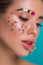 studio closeup beauty portrait with glitter