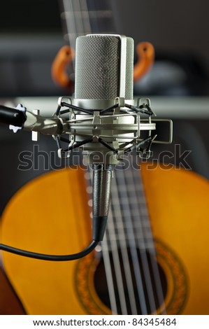 Studio condenser mic with an acoustic guitar