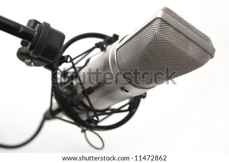 Studio condenser microphone in shock proof cage, isolated on white background
