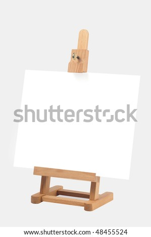 Studio easel with canvas isolated on white background