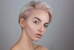 Studio fashion portrait platinum blonde girl woman with pink hair