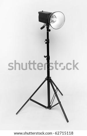 Studio flash on light grey background