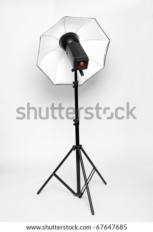 Studio flash with soft-box on a white background.