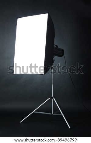 Studio flash with soft-box  on black studio background