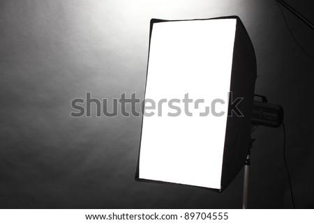 Studio flash with soft-box  on grey background