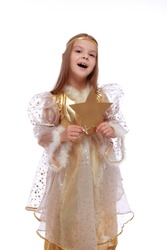 Studio image of a beautiful happy young girl with long hair in fancy dress holding gold star isolated on white
